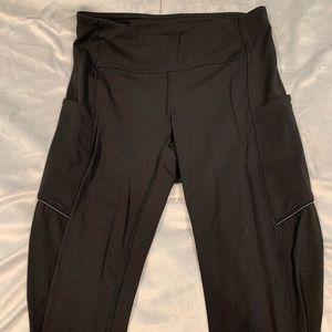 All black Lululemon leggings with pockets